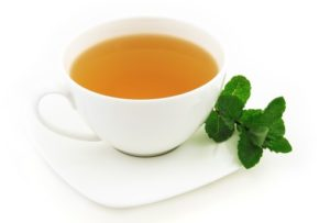 Green tea's benefits include hormone balance, weight management, liver detoxification, anti-oxidant source and reducing risk of disease development.